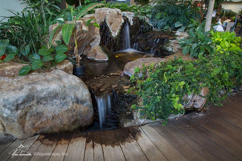 The large Pondless Waterfall at the entrance to our Water Gardening Store features impressive stones.
